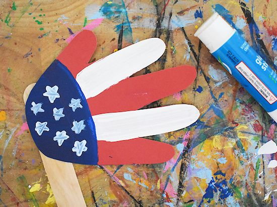 handprint flag craft glued to jumbo craft stick